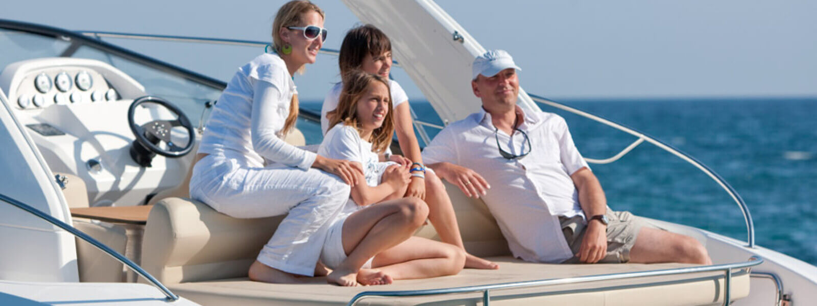 Family enjoying day on a yacht